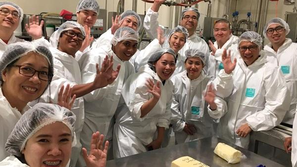 Alumni visiting a cheese factory